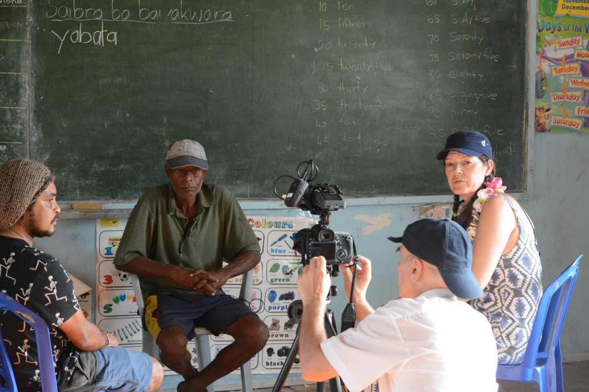 Artists Newell Harry and Armin Linke and Expedition Leader Ute Meta Bauer in Boga Boga Elementary School, Boga Boga, Cape Vogel, Papua New Guinea, October 2015. Photograph: Jegan Vincent de Paul. Copyright TBA21