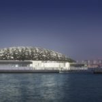 Louvre Abu Dhabi's exterior with Abu Dhabi's skyline (night) © Louvre Abu Dhabi, Photography: Mohamed Somji