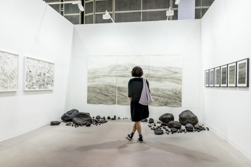 Ali Kazim at the booth of Jhveri Contemporary, Mumbai, at Art Basel Hong Kong 2018