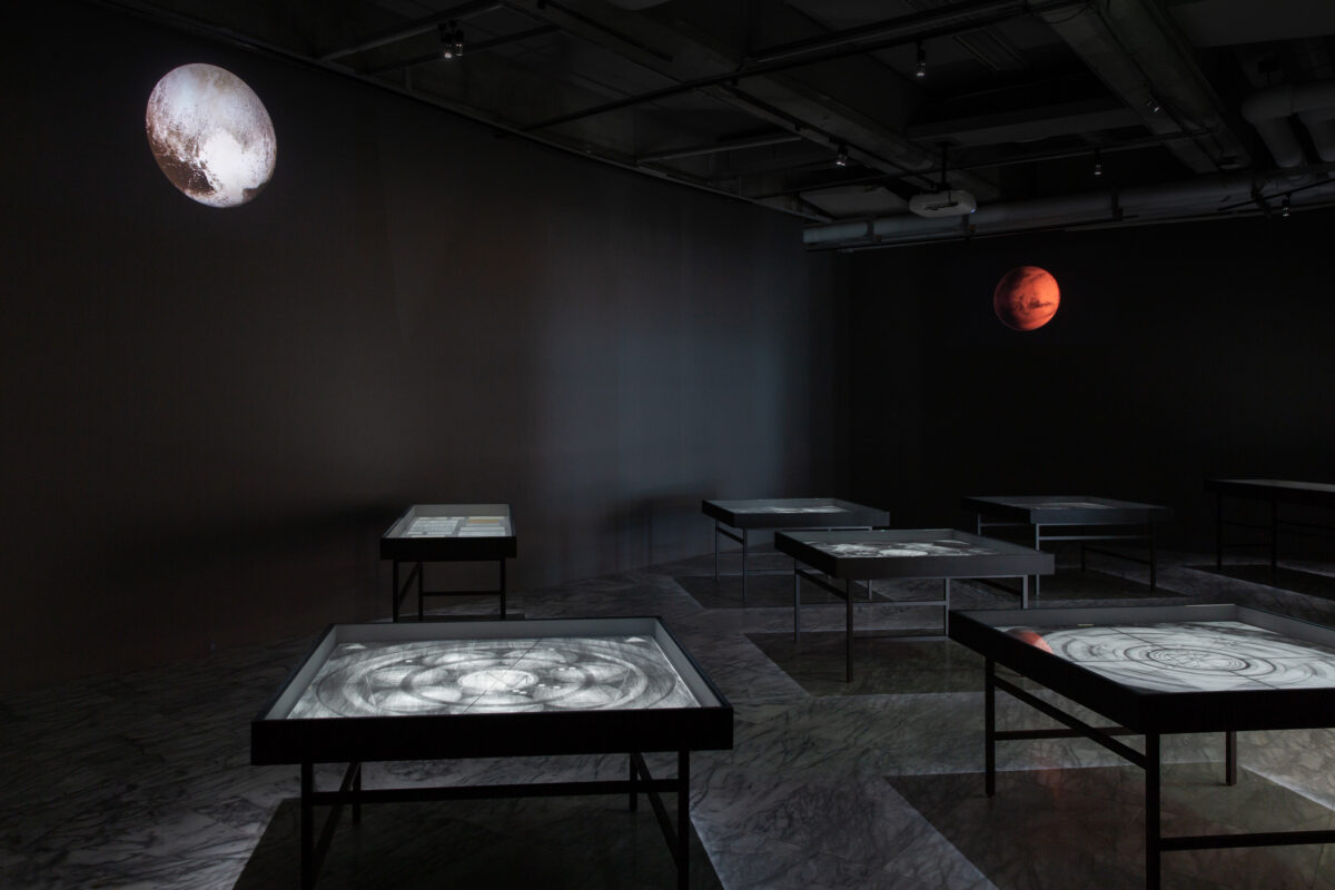 Chen Yin-Ju, Liquidation Maps, 2014, 5 charcoal and pencil drawings on paper (each 125×126 cm), printed documents, study notes, HD videos in a loop (source: NASA), dimension variable. Courtesy of the Artist and Taipei Fine Arts Museum.